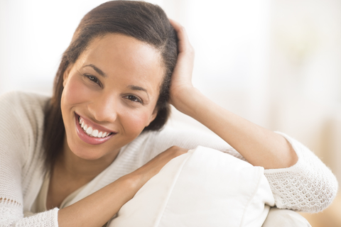 smiling woman at home comfort, security company